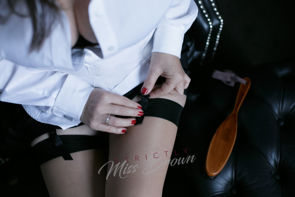 london mistress strictly miss brown adorned in silk stockings and office fetish wear